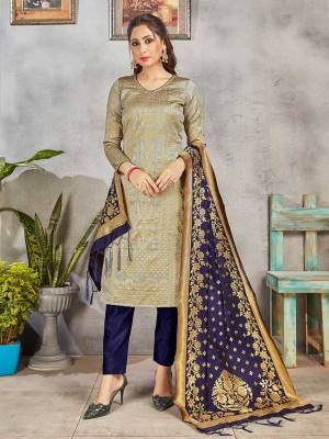 Celebrate This Festive Season Wearing this Designer Straight Suit In Grey and Navy Blue Color. Its Top, Bottom And Dupatta Are Fabricated Banarasi Art Silk Beautified With Weave. Buy This  Suit Now.