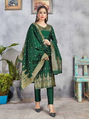 Celebrate This Festive Season Wearing this Designer Straight Suit In Pine Green Color. Its Top, Bottom And Dupatta Are Fabricated Banarasi Art Silk Beautified With Weave. Buy This  Suit Now.