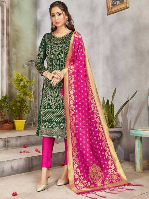 Grab This Pretty Designer Straight Suit In Dark Green And Rani Pink. Its Top, Bottom And Dupatta Are Fabricated On Banarasi Art Silk Beautified With Weave. Its Fabric and Color Gives A Rich Look To Your Perosnality.