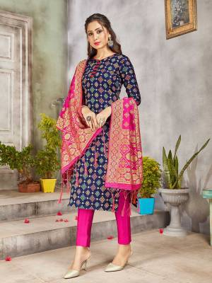 Celebrate This Festive Season Wearing this Designer Straight Suit In Navy Blue And Rani Pink Color. Its Top, Bottom And Dupatta Are Fabricated Banarasi Art Silk Beautified With Weave. Buy This  Suit Now.