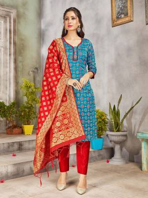 Grab This Pretty Designer Straight Suit In Blue And Red. Its Top, Bottom And Dupatta Are Fabricated On Banarasi Art Silk Beautified With Weave. Its Fabric and Color Gives A Rich Look To Your Perosnality.
