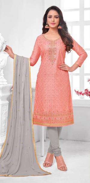 Here Is A Pretty Designer Straight Suit In Peach Color Paired With Contrasting Light Grey Colored Bottom and Dupatta. Its Top Is Modal Silk Based Paired With Cotton Bottom and Chiffon Dupatta. All Its Fabrics Are Light Weight And Easy To Carry All Day Long