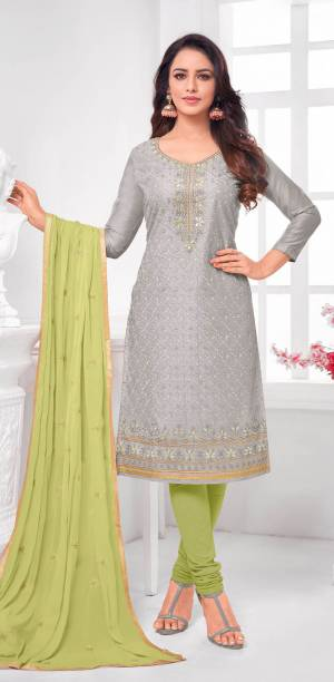 Here Is A Pretty Designer Straight Suit In Grey Color Paired With Contrasting Light Green Colored Bottom and Dupatta. Its Top Is Modal Silk Based Paired With Cotton Bottom and Chiffon Dupatta. All Its Fabrics Are Light Weight And Easy To Carry All Day Long