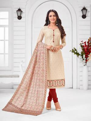 Grab This Designer Straight Suit For Your Semi-Casual Wear In Cream Color Paired With Maroon Colored Bottom and Cream Dupatta. Its Top and Dupatta Are Modal Silk Based Paired With Cotton Bottom.