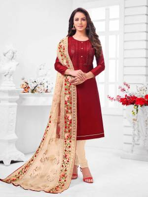 Simple And Elegant Looking Designer Straight Suit Is Here In Maroon Color Paired With Cream Colored bottom And Dupatta. Its Top Is Fabricated On Coral Silk Paired With Cotton Bottom and Orgenza Dupatta.