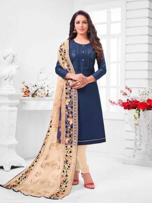 Simple And Elegant Looking Designer Straight Suit Is Here In Navy Blue Color Paired With Cream Colored bottom And Dupatta. Its Top Is Fabricated On Coral Silk Paired With Cotton Bottom and Orgenza Dupatta.