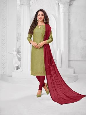 Here Is A Pretty Designer Straight Suit In Olive Green Color Paired With?Contrasting Magenta Pink Colored Bottom and Dupatta. Its Top Is Cotton Silk Based Paired With Cotton Bottom and Chiffon Dupatta. All Its Fabrics Are Light Weight And Easy To Carry All Day Long.