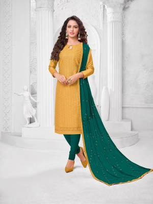Here Is A Pretty Designer Straight Suit In Musturd Yellow Color Paired With?Contrasting Teal Blue Colored Bottom and Dupatta. Its Top Is Cotton Silk Based Paired With Cotton Bottom and Chiffon Dupatta. All Its Fabrics Are Light Weight And Easy To Carry All Day Long.