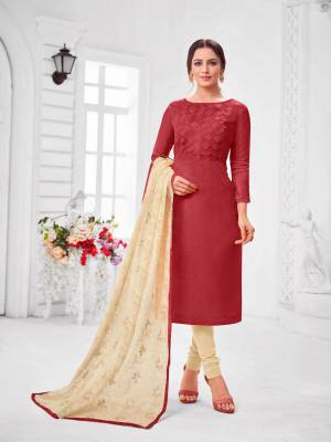 You Will Definitely Earn Lots Of Compliments Wearing This Designer?Straight Suit In Maroon Colored Top Paired With Cream Colored Bottom And Dupatta. Its Top Is Fancy Fabric Based Paired With Cotton Bottom and Chiffon Fabricated Dupatta