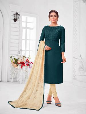 You Will Definitely Earn Lots Of Compliments Wearing This Designer?Straight Suit In Teal Blue Colored Top Paired With Cream Colored Bottom And Dupatta. Its Top Is Fancy Fabric Based Paired With Cotton Bottom and Chiffon Fabricated Dupatta