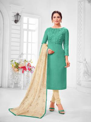 You Will Definitely Earn Lots Of Compliments Wearing This Designer?Straight Suit In Turquoise Blue Colored Top Paired With Cream Colored Bottom And Dupatta. Its Top Is Fancy Fabric Based Paired With Cotton Bottom and Chiffon Fabricated Dupatta