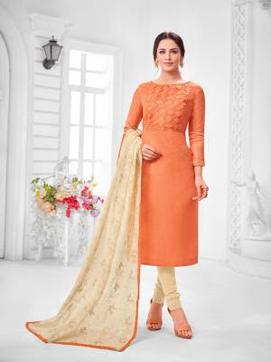 You Will Definitely Earn Lots Of Compliments Wearing This Designer?Straight Suit In Orange Colored Top Paired With Cream Colored Bottom And Dupatta. Its Top Is Fancy Fabric Based Paired With Cotton Bottom and Chiffon Fabricated Dupatta