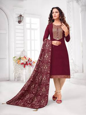 Grab This Designer Straight Suit For Your Semi-Casual Wear In Maroon Colored Top and Dupatta Paired With Cream Colored Bottom. Its Top and Dupatta Are Art Silk Based Paired With Cotton Bottom.