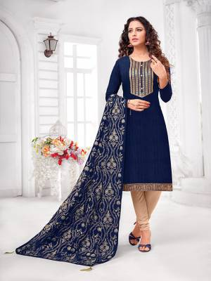 Grab This Designer Straight Suit For Your Semi-Casual Wear In Navy Blue Colored Top and Dupatta Paired With Cream Colored Bottom. Its Top and Dupatta Are Art Silk Based Paired With Cotton Bottom.