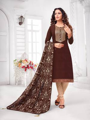 Grab This Designer Straight Suit For Your Semi-Casual Wear In Brown Colored Top and Dupatta Paired With Cream Colored Bottom. Its Top and Dupatta Are Art Silk Based Paired With Cotton Bottom.