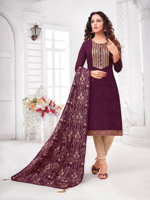 Grab This Designer Straight Suit For Your Semi-Casual Wear In Wine Colored Top and Dupatta Paired With Cream Colored Bottom. Its Top and Dupatta Are Art Silk Based Paired With Cotton Bottom.