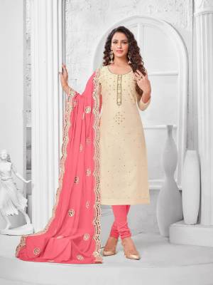 Here Is A Pretty Designer Straight Suit In Cream Color Paired With Contrasting Pink Colored Bottom and Dupatta. Its Top Is Modal Silk Based Paired With Cotton Bottom and Chiffon Dupatta. All Its Fabrics Are Light Weight And Easy To Carry All Day Long