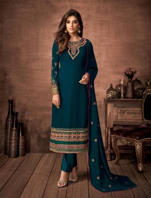 Here Is A Very Pretty Designer Straight Suit In Teal Blue Color. Its Embroidered Top and Dupatta Are Fabricated On Georgette Paired with Santoon Fabricated Bottom. Its Fabrics Are Soft Towards Skin And Esnures Superb Comfort All Day Long.