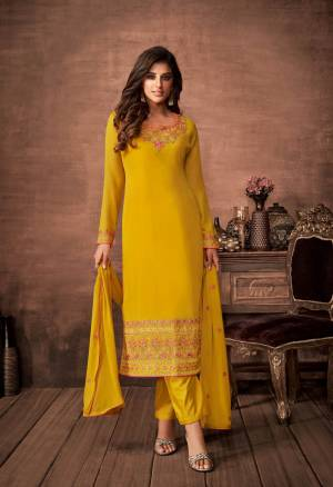 Here Is A Very Pretty Designer Straight Suit In Yellow Color. Its Embroidered Top and Dupatta Are Fabricated On Georgette Paired with Santoon Fabricated Bottom. Its Fabrics Are Soft Towards Skin And Esnures Superb Comfort All Day Long.