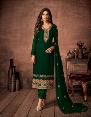Here Is A Very Pretty Designer Straight Suit In Dark Green Color. Its Embroidered Top and Dupatta Are Fabricated On Georgette Paired with Santoon Fabricated Bottom. Its Fabrics Are Soft Towards Skin And Esnures Superb Comfort All Day Long.