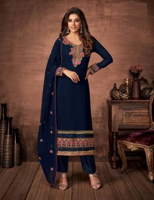 Here Is A Very Pretty Designer Straight Suit In Navy Blue Color. Its Embroidered Top and Dupatta Are Fabricated On Georgette Paired with Santoon Fabricated Bottom. Its Fabrics Are Soft Towards Skin And Esnures Superb Comfort All Day Long.
