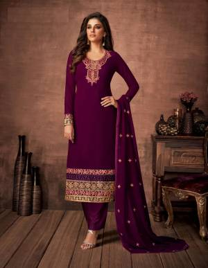 Here Is A Very Pretty Designer Straight Suit In Purple Color. Its Embroidered Top and Dupatta Are Fabricated On Georgette Paired with Santoon Fabricated Bottom. Its Fabrics Are Soft Towards Skin And Esnures Superb Comfort All Day Long.