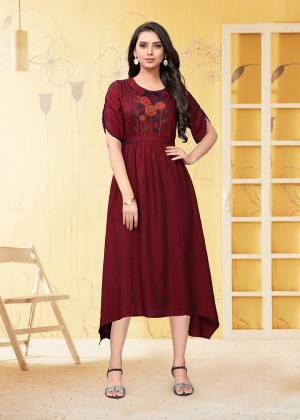 Add This Pretty Readymade Kurti To Your Wardrobe In Maroon Color. This Kurti Is Fabricated On Linen Beautified With Thread Work.