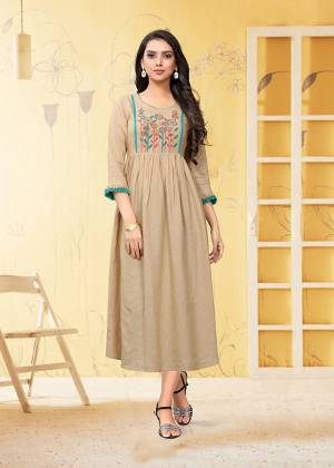 Grab This Readymade Kurti In Beige Which Is Suitable For The Upcoming Festive Season. This Pretty Kurti Is Fabricated On Linen Beautified With Thread Work. It Is Light Weight and Available In All Regular Sizes.
