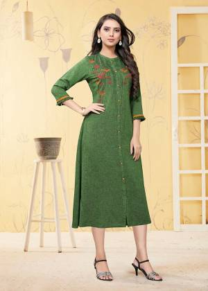 Add This Pretty Readymade Kurti To Your Wardrobe In Green Color. This Kurti Is Fabricated On Linen Beautified With Thread Work.