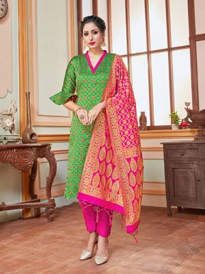Here Is A Rich And Elegant Looking Silk Based Straight Suit In Green Colored Top Paired With Contrasting Rani Pink Colored Bottom And Dupatta. Its Top, Bottom And Dupatta Are Fabricated On Banarasi Silk Beautified With Heavy Detailed Weave.