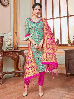 Celebrate This Festive Season In A Proper Traditional Look Wearing This Weaved Straight Suit In Turquoise Blue Colored Top Paired With Contrasting Rani Pink Colored Bottom And Dupatta. This Pretty Suit Is Banarasi Silk Based Beautified With Weave. Its Fabric Gives A Rich Look To Your Personality.