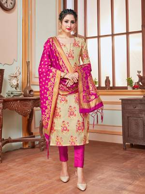 Here Is A Rich And Elegant Looking Silk Based Straight Suit In Beige Colored Top Paired With Contrasting Dark Pink Colored Bottom And Dupatta. Its Top, Bottom And Dupatta Are Fabricated On Banarasi Silk Beautified With Heavy Detailed Weave.