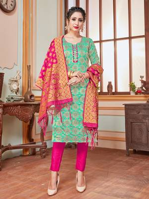 Here Is A Rich And Elegant Looking Silk Based Straight Suit In Sea Green Colored Top Paired With Contrasting Rani Pink Colored Bottom And Dupatta. Its Top, Bottom And Dupatta Are Fabricated On Banarasi Silk Beautified With Heavy Detailed Weave.