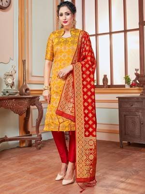 Celebrate This Festive Season In A Proper Traditional Look Wearing This Weaved Straight Suit In Musturd Yellow Colored Top Paired With Contrasting Red Colored Bottom And Dupatta. This Pretty Suit Is Banarasi Silk Based Beautified With Weave. Its Fabric Gives A Rich Look To Your Personality.