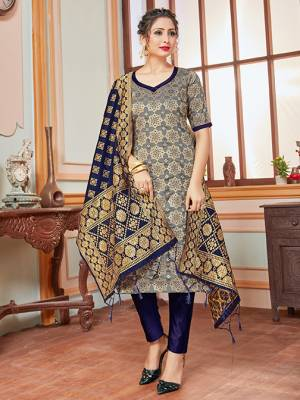 Here Is A Rich And Elegant Looking Silk Based Straight Suit In Dark Grey Colored Top Paired With Contrasting Navy Blue Colored Bottom And Dupatta. Its Top, Bottom And Dupatta Are Fabricated On Banarasi Silk Beautified With Heavy Detailed Weave.