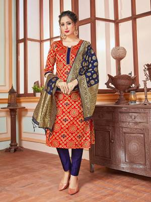 Celebrate This Festive Season In A Proper Traditional Look Wearing This Weaved Straight Suit In Red Colored Top Paired With Contrasting Navy BLue Colored Bottom And Dupatta. This Pretty Suit Is Banarasi Silk Based Beautified With Weave. Its Fabric Gives A Rich Look To Your Personality.