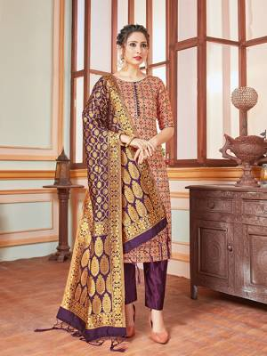 Here Is A Rich And Elegant Looking Silk Based Straight Suit In Beige Colored Top Paired With Contrasting Purple Colored Bottom And Dupatta. Its Top, Bottom And Dupatta Are Fabricated On Banarasi Silk Beautified With Heavy Detailed Weave.