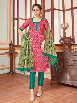 Here Is A Rich And Elegant Looking Silk Based Straight Suit In Dark Pink Colored Top Paired With Contrasting Sea Green Colored Bottom And Dupatta. Its Top, Bottom And Dupatta Are Fabricated On Banarasi Silk Beautified With Heavy Detailed Weave.