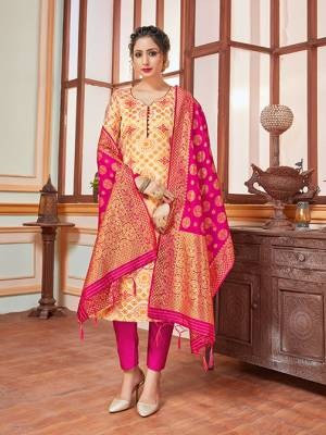 Celebrate This Festive Season In A Proper Traditional Look Wearing This Weaved Straight Suit In Cream Colored Top Paired With Contrasting Rani Pink Colored Bottom And Dupatta. This Pretty Suit Is Banarasi Silk Based Beautified With Weave. Its Fabric Gives A Rich Look To Your Personality.
