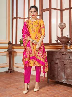 Here Is A Rich And Elegant Looking Silk Based Straight Suit In Musturd Yellow Colored Top Paired With Contrasting Rani Pink Colored Bottom And Dupatta. Its Top, Bottom And Dupatta Are Fabricated On Banarasi Silk Beautified With Heavy Detailed Weave.