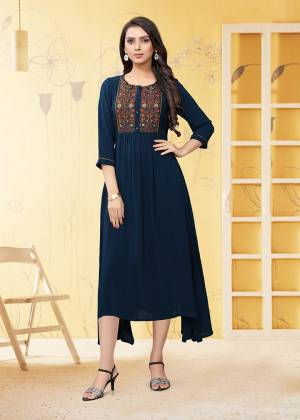 Here Is A Prefect Kurti For The Upcoming Festive Season In Navy Blue Color. This Readymade Kurti Is Fabricated On Georgette Beautified With Thread Work. It Is Light In Weight And Available In All Regular Sizes.