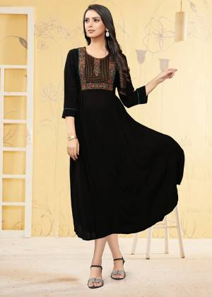 Here Is A Prefect Kurti For The Upcoming Festive Season In Black Color. This Readymade Kurti Is Fabricated On Georgette Beautified With Thread Work. It Is Light In Weight And Available In All Regular Sizes.