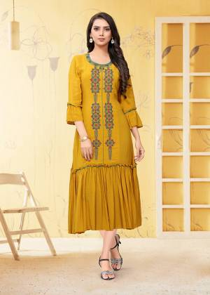 Here Is A Prefect Kurti For The Upcoming Festive Season In Musturd Yellow Color. This Readymade Kurti Is Fabricated On Georgette Beautified With Thread Work. It Is Light In Weight And Available In All Regular Sizes.