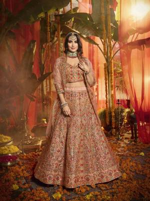 Get Ready For The Upcoming Wedding Season With This Very Beautiful Heavy Designer Lehenga Choli In Peach Color. This Lehenga Choli Is Fabricated On Orgenza Beautified With Lovely Embroidery Paired With Net Fabricated Dupatta. Buy Now.