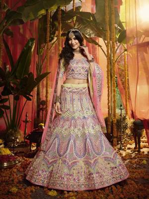 Here Is A Very Beautiful Heavy Embroidered Designer Lehenga Choli In Cream Color Paired With Contrasting Pink Colored Dupatta. Its Lovely Blouse and Lehenga are Fabricated On Orgenza Paired With  Net Fabricated Dupatta. Its Pretty Color Pallete And Attractive Embroidery Will Earn You Lots Of Compliments From Onlookers.