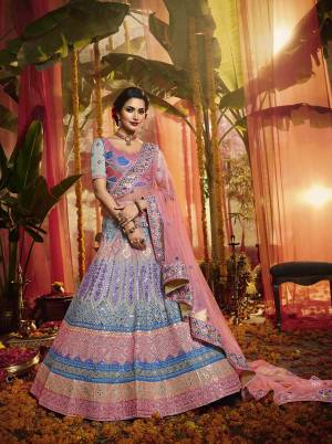 Get Ready For The Upcoming Wedding Season With This Very Beautiful Heavy Designer Lehenga Choli In Grey Color Paired With Contrasting Pink Colored Dupatta. This Lehenga Choli Is Fabricated On Orgenza Beautified With Lovely Embroidery Paired With Net Fabricated Dupatta. Buy Now.