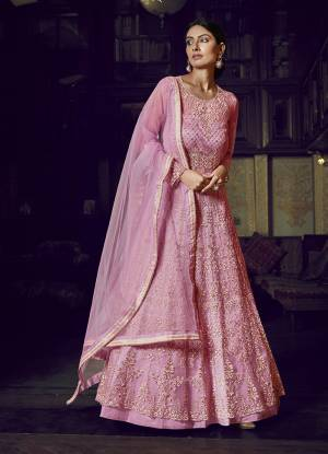 Look Pretty In This Beautiful Designer Floor Length Gown In Pink Color Paired With Pink Colored Dupatta. This Semi-Stitched Gown And Dupatta Are Fabricated On Net Beautified With Pretty Embroidery. Buy Now.