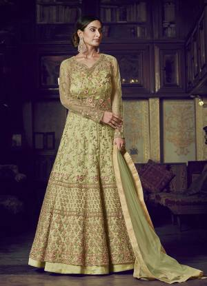 Flaunt Your Rich And Elegant Taste Wearing This Designer Semi-Stitched Floor Length Gown In Light Green Color Paired With Light Green Colored Dupatta. This Pretty Gown And Dupatta Are Fabricated On Net Beautified With Pretty Embroidery Giving An Attractive Look.