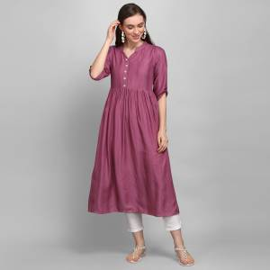 Simple and Elegant Looking Readymade Kurti Is Here In Wine Color. This Pretty Kurti Is Fabricated On Rayon Which Is Soft Towards Skin And Easy To Carry All Day Long. Also, You Can Style This Plain Kurti In Many Ways As Per The Occasion.