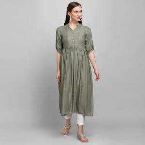Must Have Piece To Your Wardrobe Is Here With This Readymade Kurti In Olive Grey Color Fabricated On Rayon With Self Work. This Kurti Is Suitable For Semi-Casual As Well As Festive Wear When Styled With Oxidize Jewelley And Sheer Dupatta.